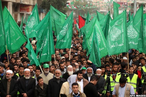 Palestinians Hamas supporters take part in a rally ahead of the 27th anniversary of the movement founding, in Jabaliya in the northern Gaza Strip December 12, 2014. Photo by Ashraf Amra